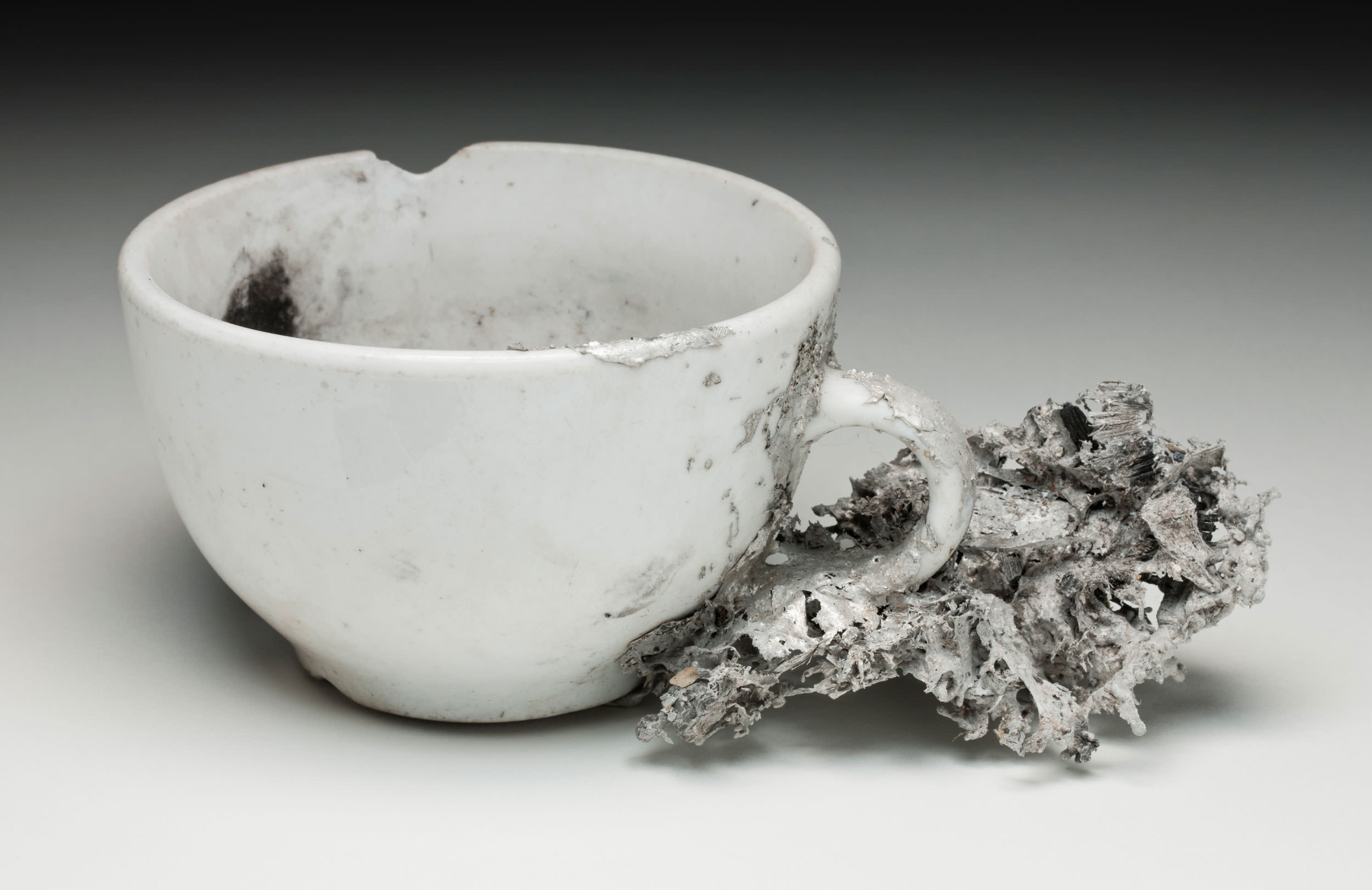 Teacup and aluminium shard from Mt Stromlo Observatory